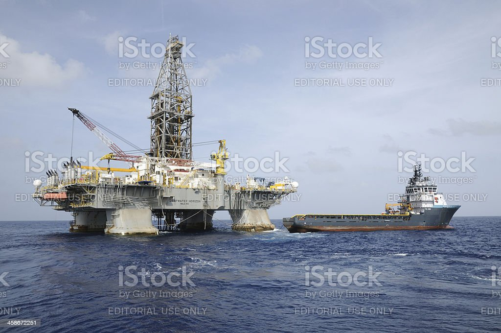 'Deepwater Horizon' offshore oil rig and Tidewater supply vessel stock photo