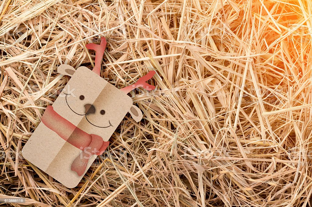 deer papercut style on hay background stock photo