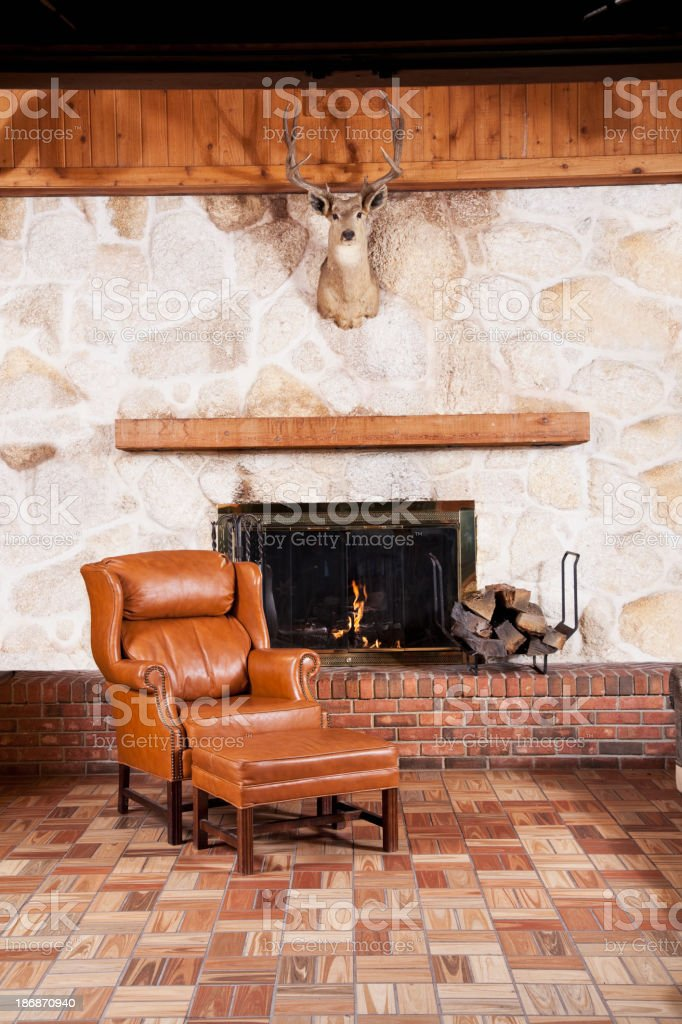 Deer trophy hanging over burning fireplace royalty-free stock photo