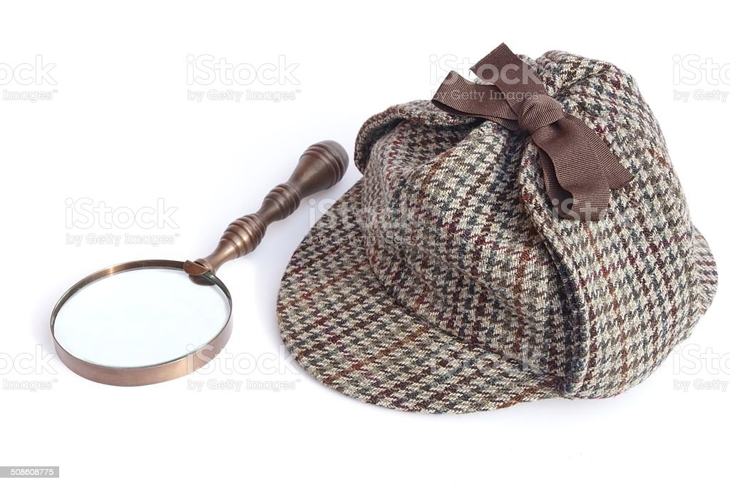 Deerstalker Cap and Vintage Magnifying Glass stock photo