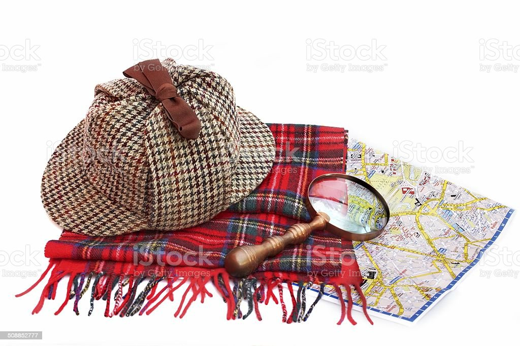 Deerstalker cap, magnifying glass, tartan scarves and London map stock photo