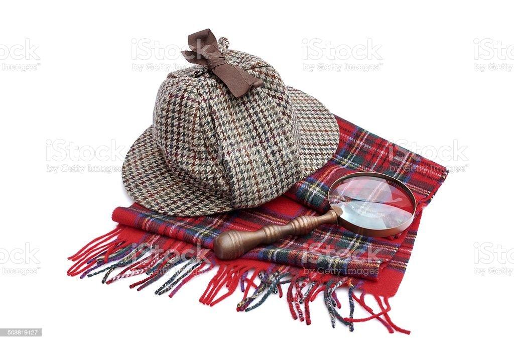 Deerstalker Hat, Magnifying Glass and Tartan Scarf stock photo