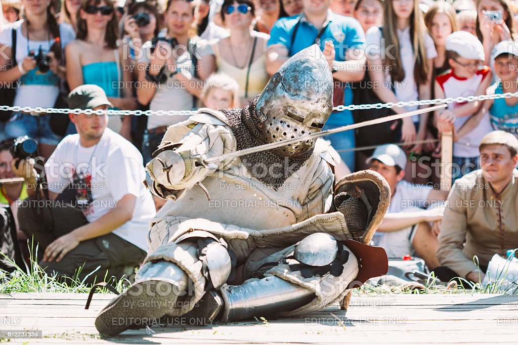 Defeated In Battle Knight Tries To Get Up From  Floor stock photo