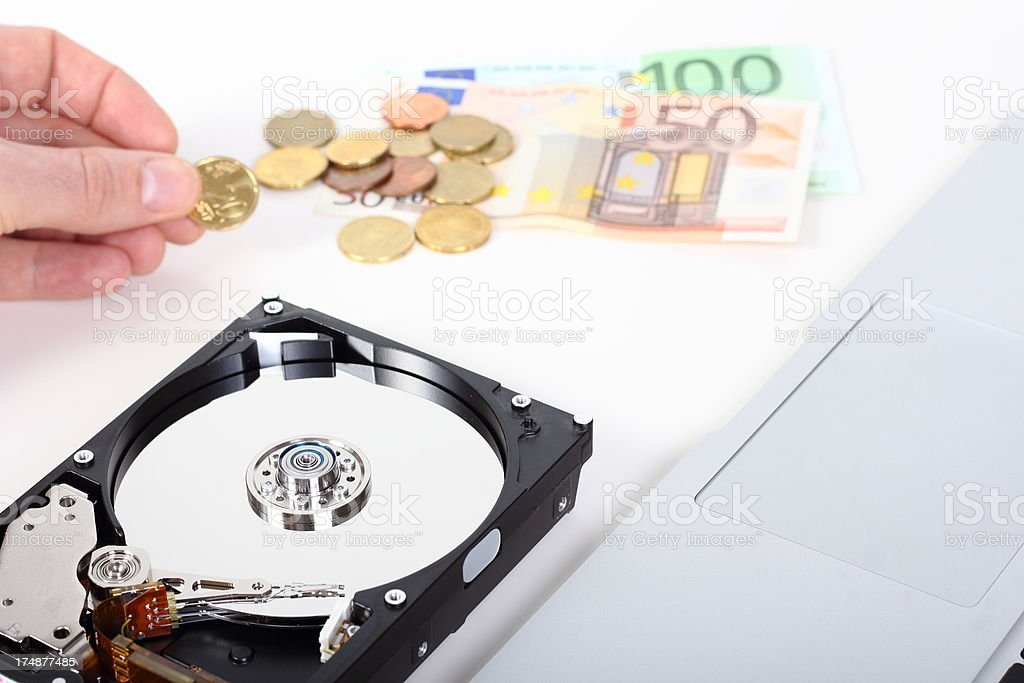 Defective hard drive and money. royalty-free stock photo