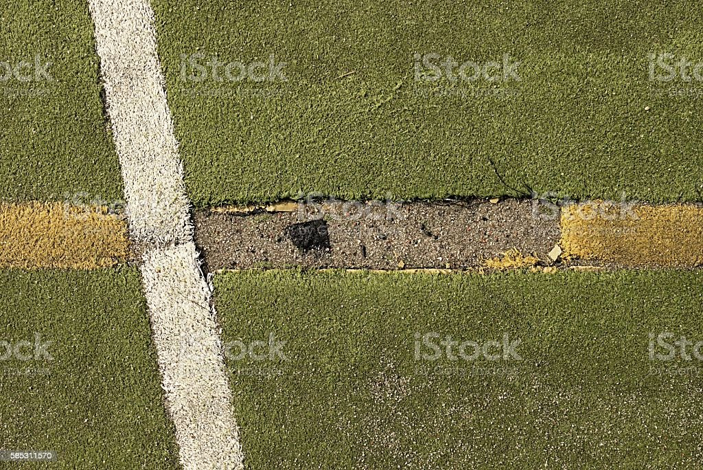 Defects in playground. Damaged lines in outdoor handball court. stock photo