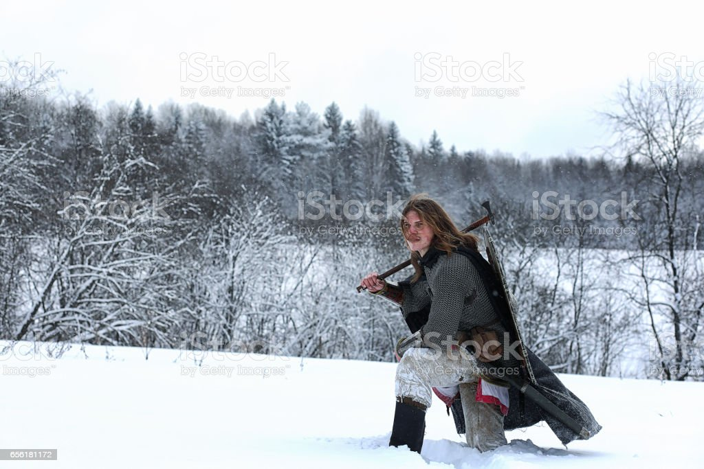 Defender the young warrior in mail armor armed with a sword stock photo