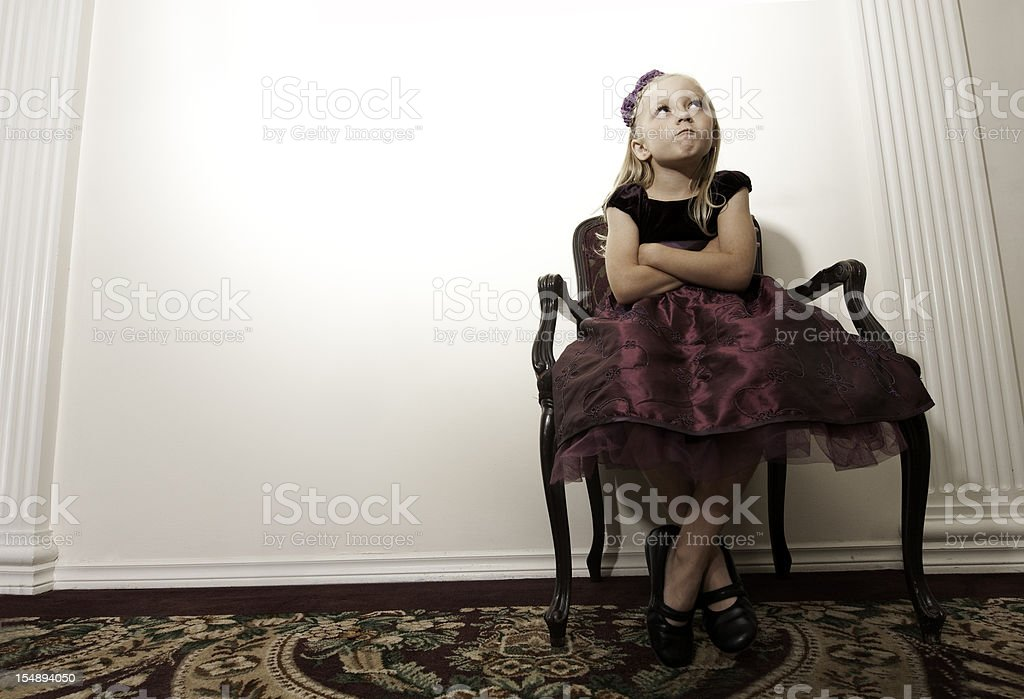Defiant Young Girl in Party Dress stock photo