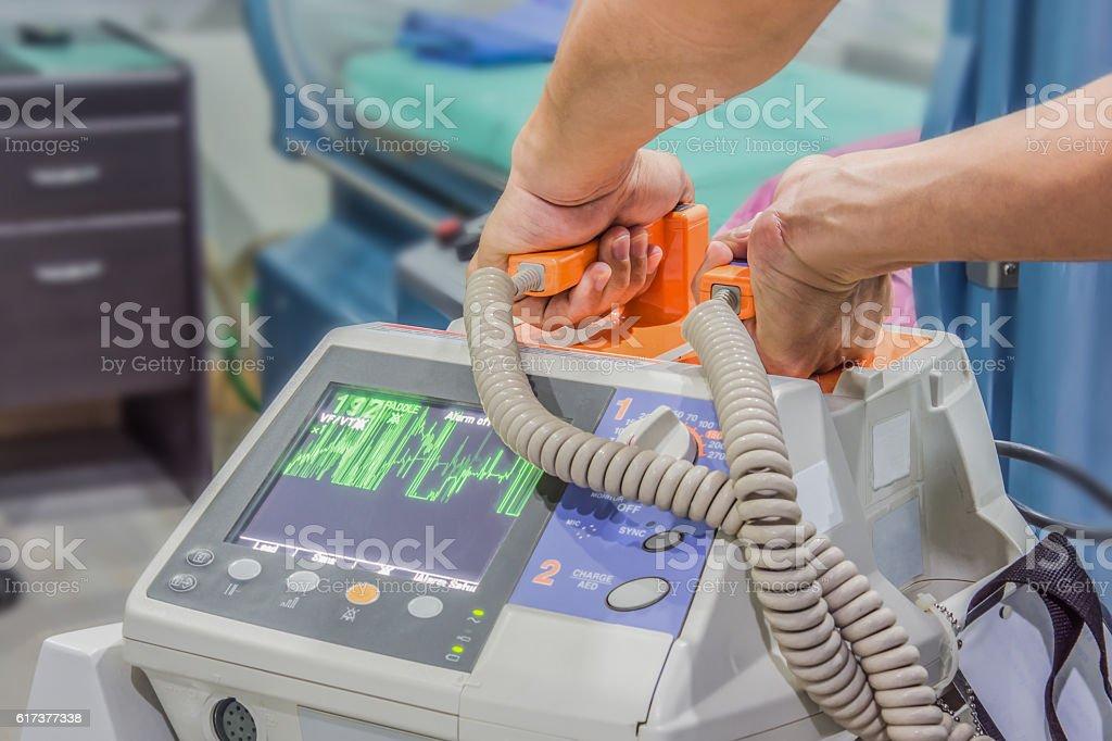 defibrillator machine blur background stock photo
