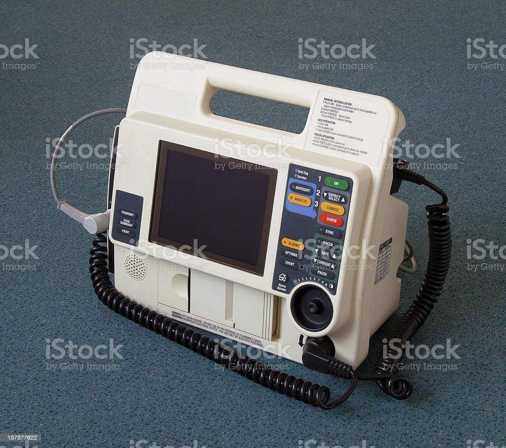 Defibrillator machine on blue floor stock photo