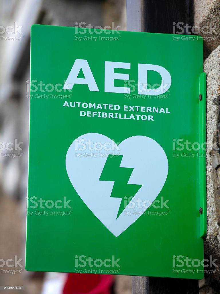 Defibrillator Sign on Wall stock photo