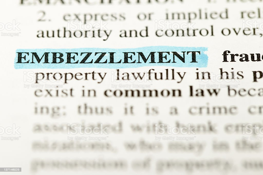 definition embezzlement highlighted stock photo