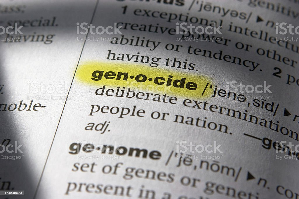 Definition of the Word Genocide (Highlighted) stock photo