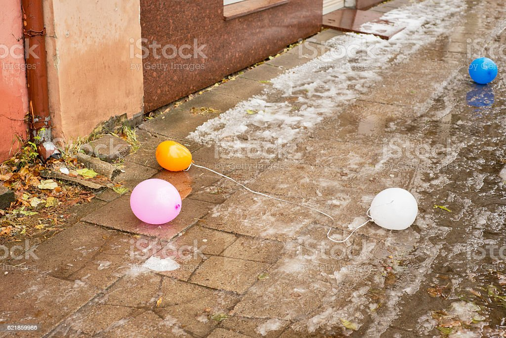 Deflated colorful air balloons stock photo