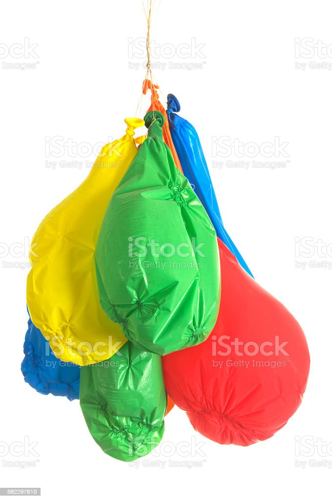 Deflated coloured balloons stock photo
