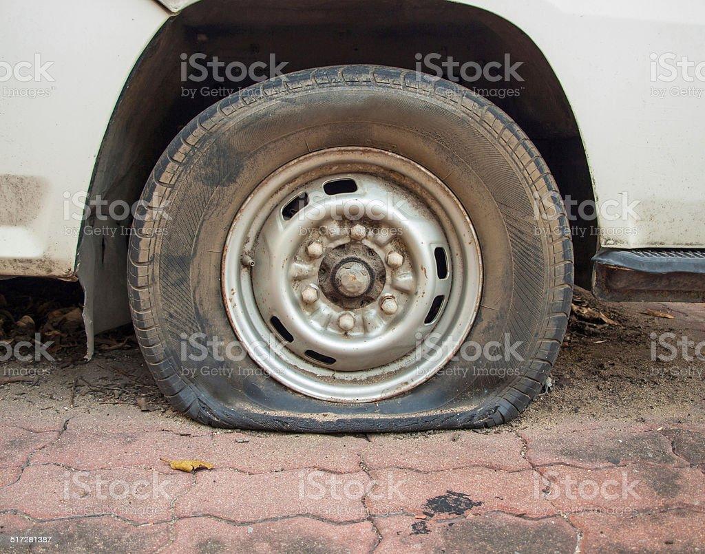 Deflated damaged tyre on car wheel stock photo