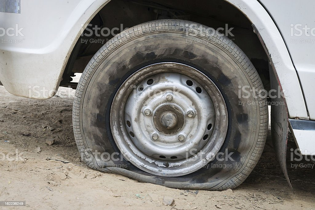 Deflated damaged tyre royalty-free stock photo