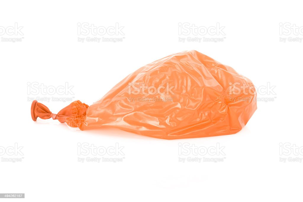 Deflated orange balloon isolated over white stock photo