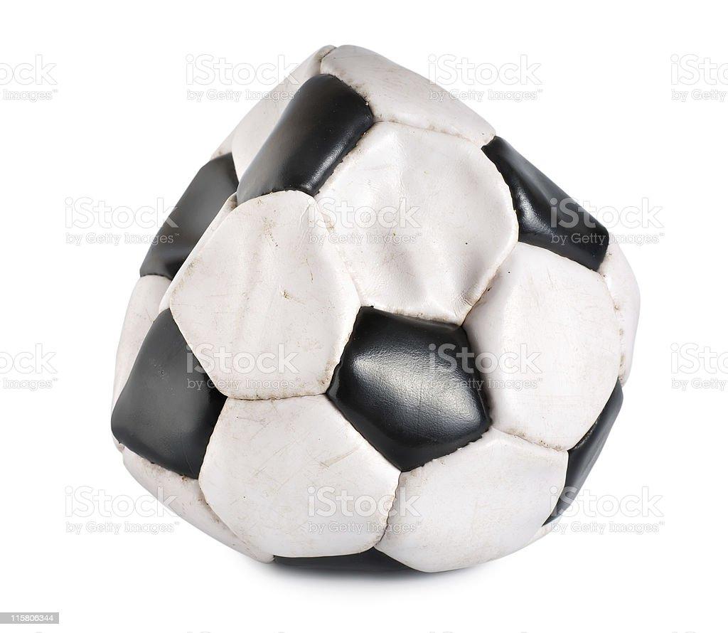 Deflated soccer ball stock photo