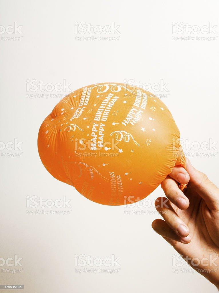 deflating birthday balloon stock photo