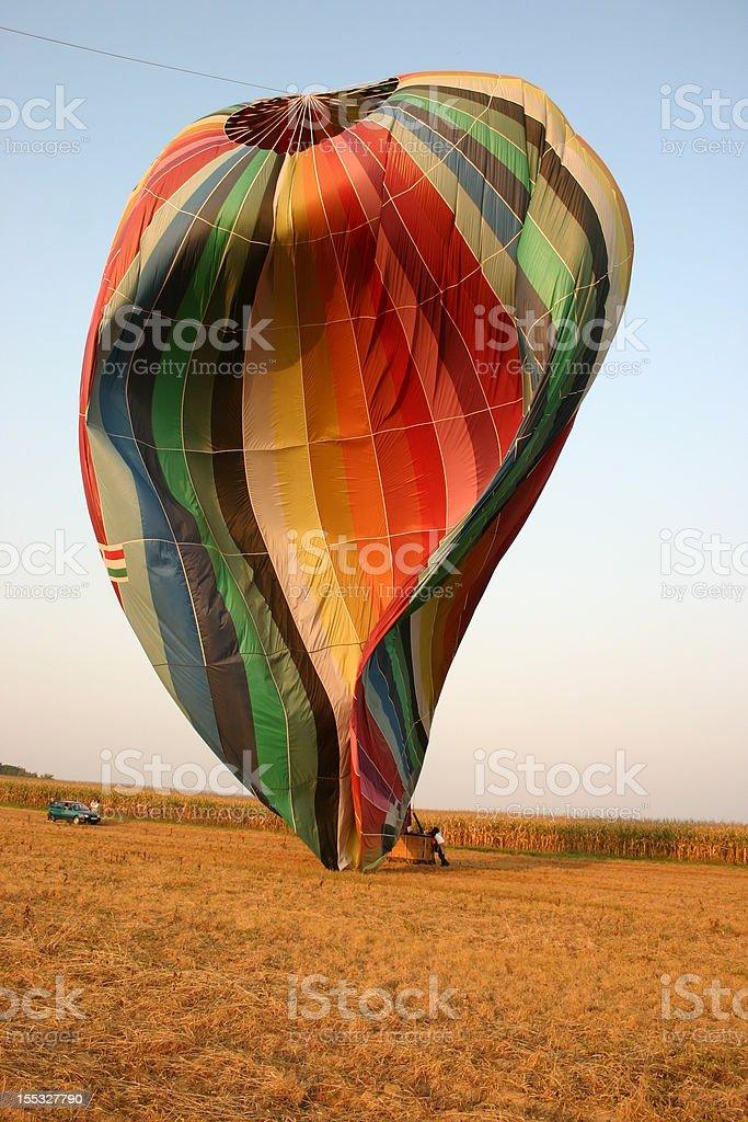 deflating hot air balloon stock photo