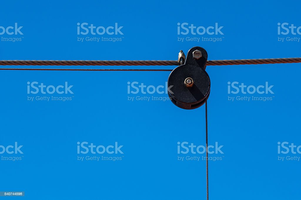 Deflector roll and steel cable on a vessel stock photo