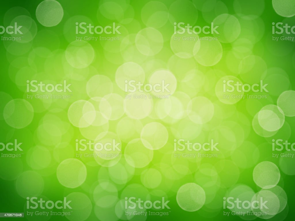 Defocused abstract lights on green background. stock photo