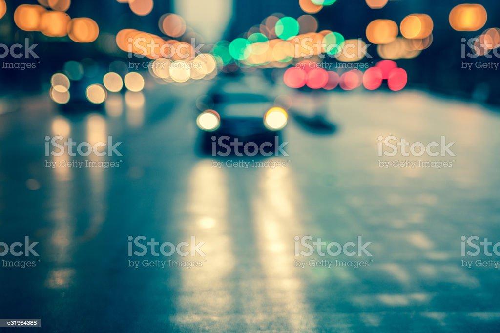 Defocused and toned rainy street scene in metropolitan area stock photo