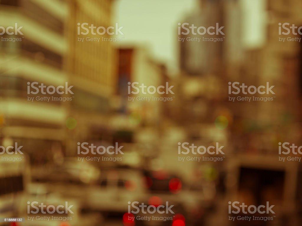 Defocused antique toned street scene in large metropolitan area stock photo