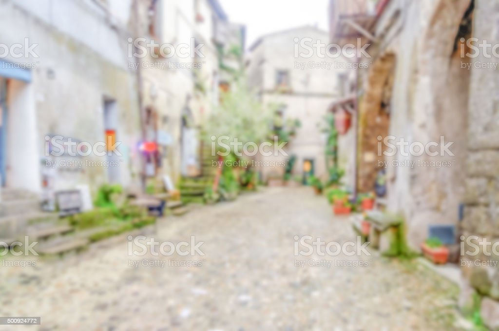 Defocused background of ancient italian small town stock photo
