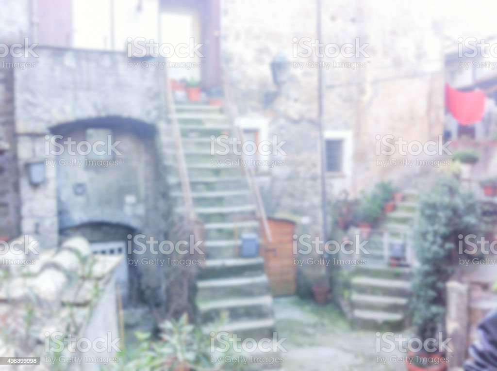 Defocused background of the ancient town of Calcata, Italy stock photo