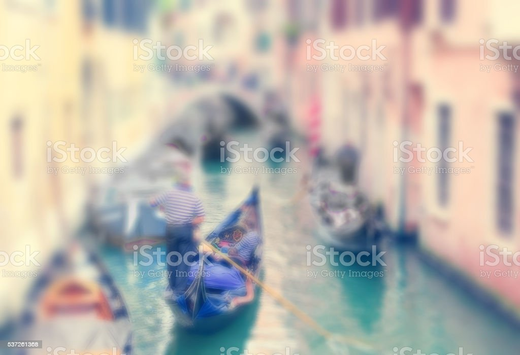 Defocused Background with gondolas along canal of Venice stock photo