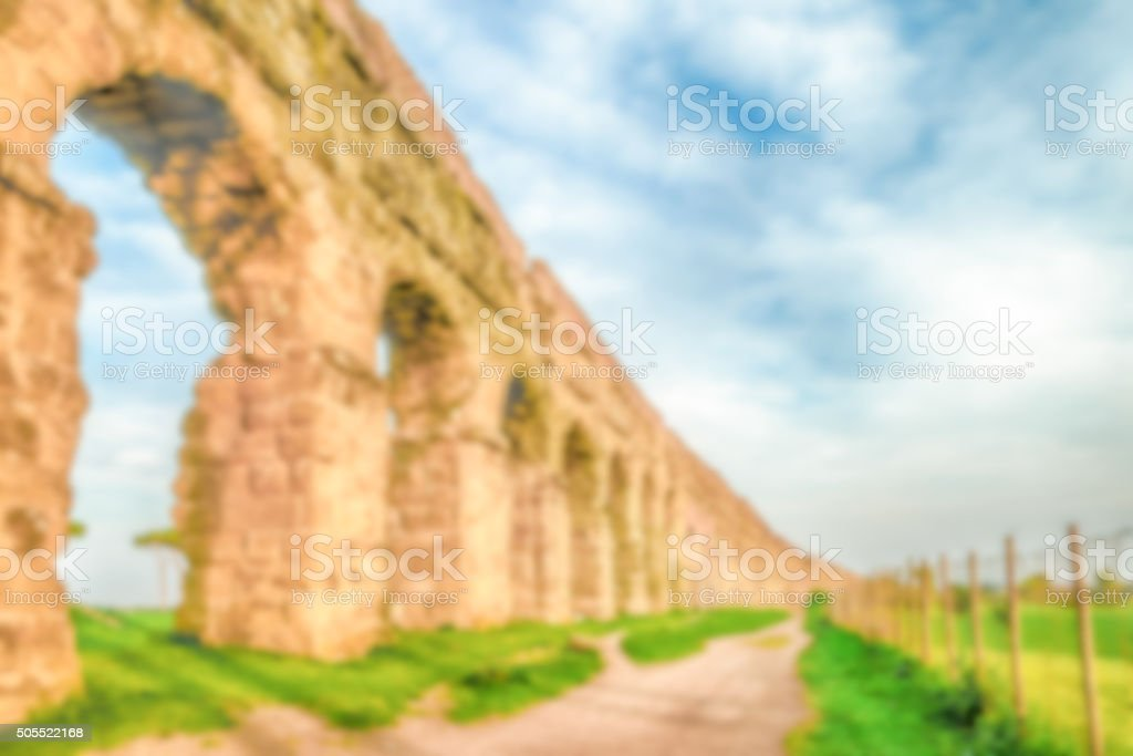 Defocused background with ruins of ancient Roman Aqueducts, Rome stock photo