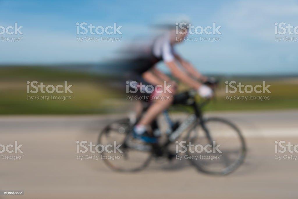 defocused bicycle sport driver on street stock photo