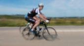 defocused bicycle sport driver on street