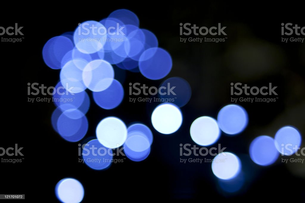 defocused blue light dots against black background royalty-free stock photo