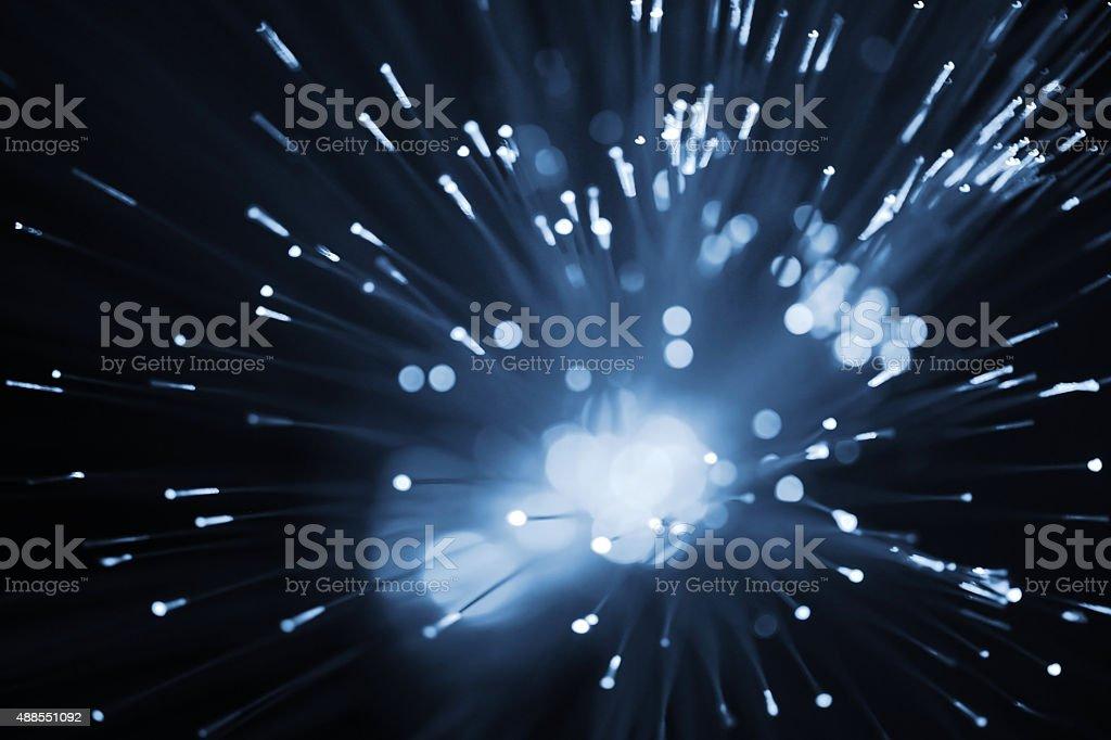 Defocused blue toned  light dots stock photo