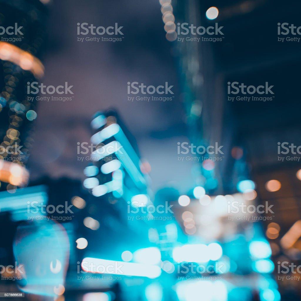 defocused blur light background in modern city at night stock photo