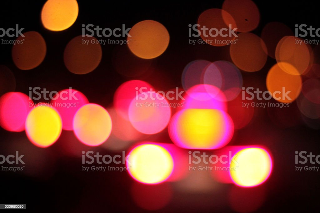 Defocused, blurry back lights of a car at night stock photo
