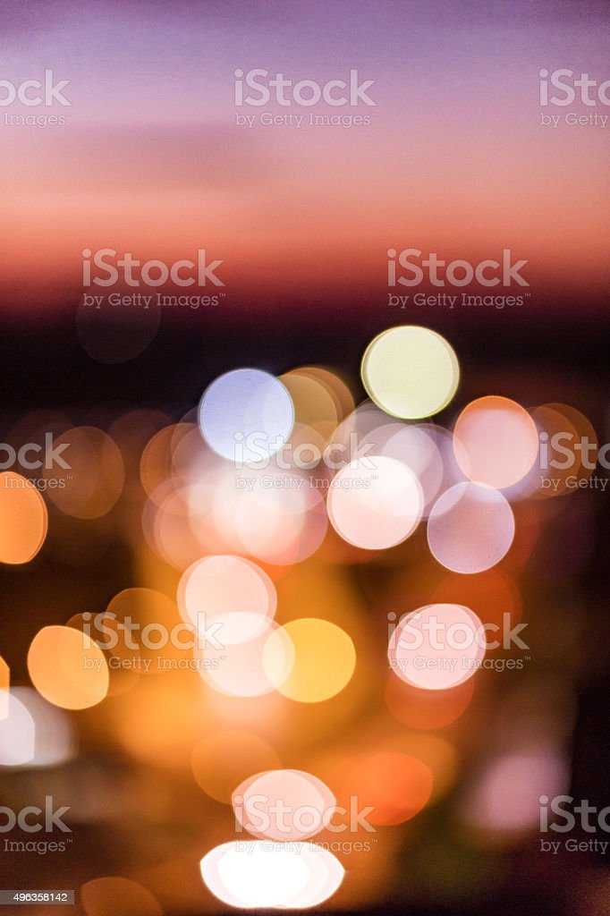 Defocused bokeh city lights after sunset background - stock image stock photo