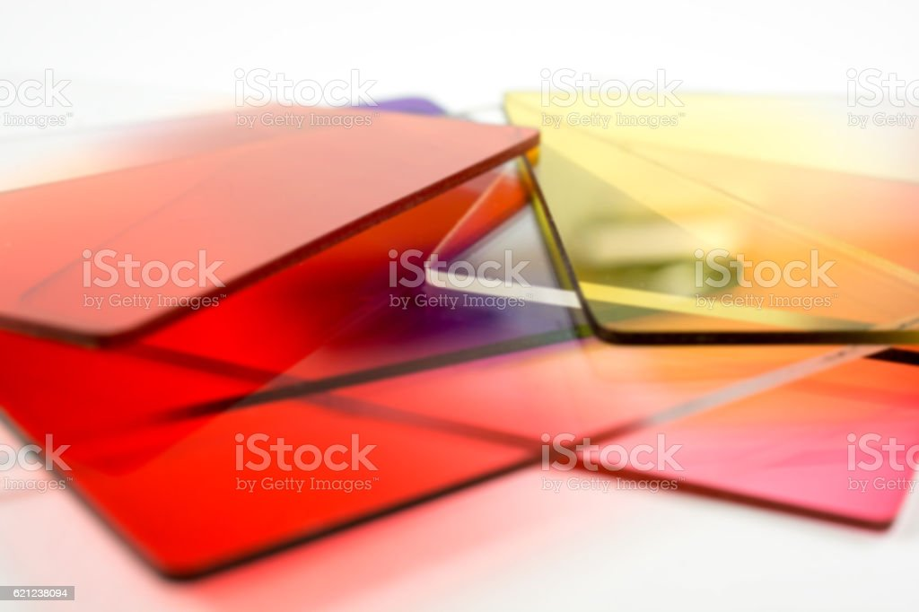 Defocused brilliant coloered photographers' lens filters - bright background stock photo