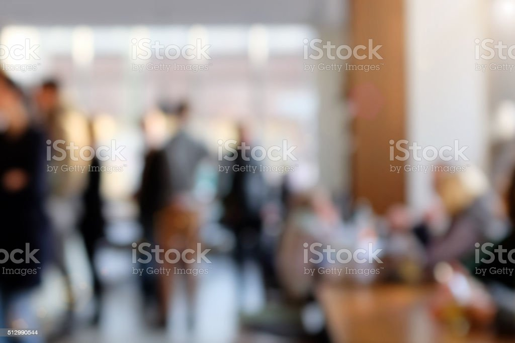 Defocused cafeteria background with people and daylight stock photo