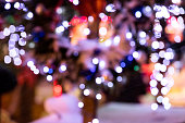 defocused chistmas lights on streets of night city