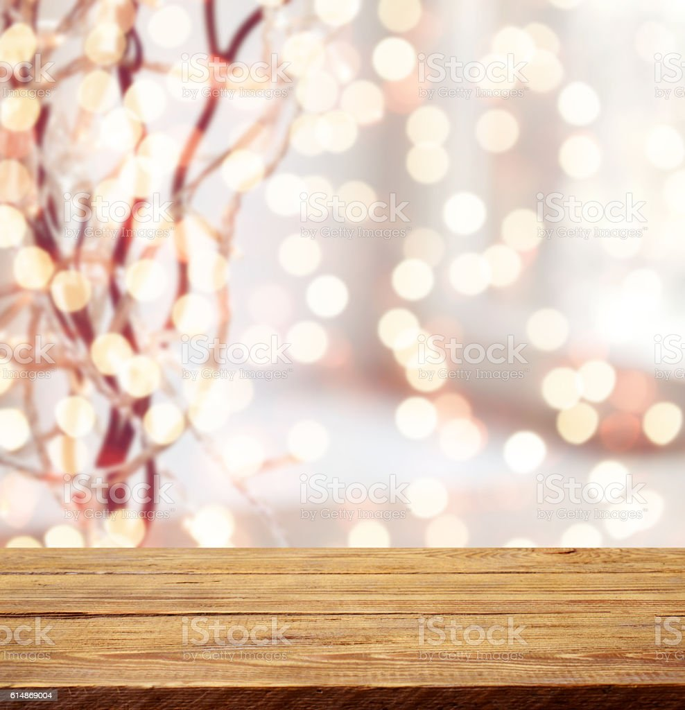 Defocused Christmas light and wooden background stock photo
