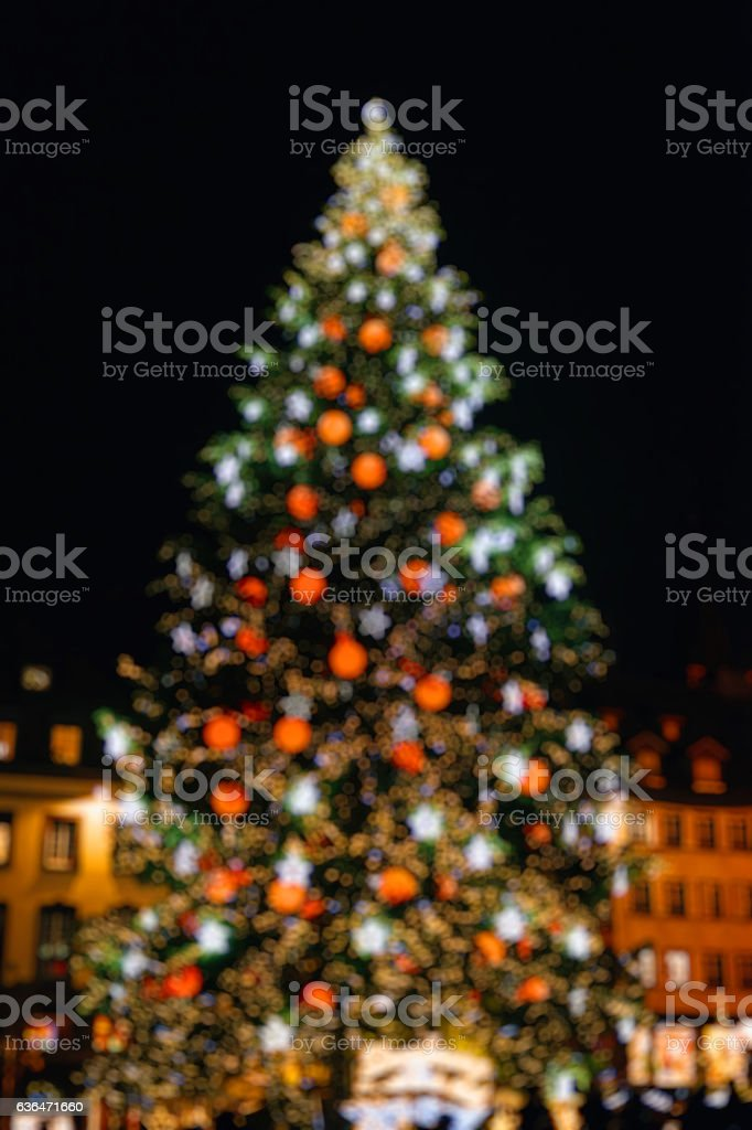 Defocused Christmas tree in central square city stock photo