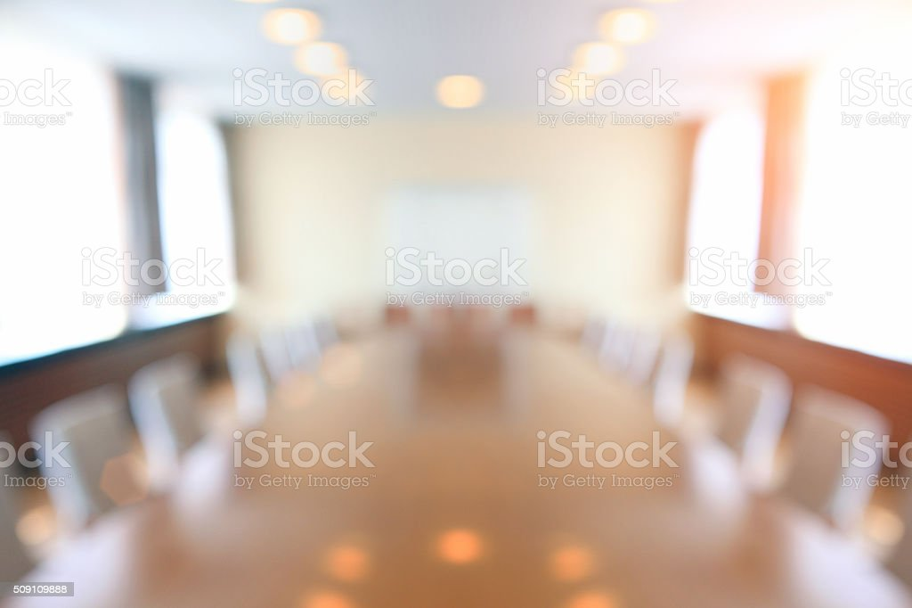 Defocused conference room with tables and chairs, bright illumination stock photo