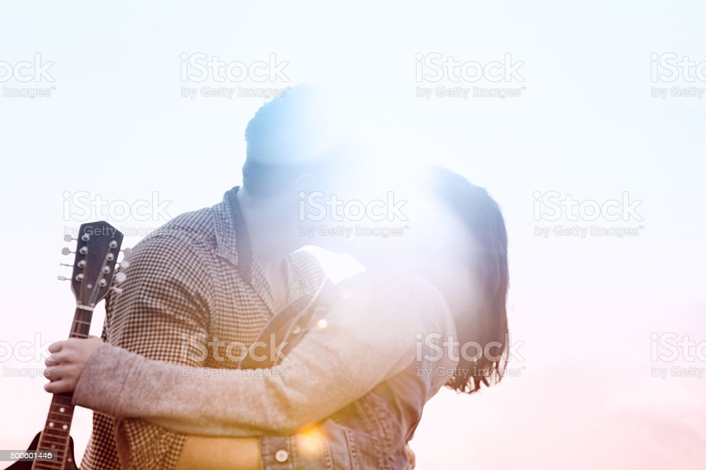 Defocused dreamlike kiss in full colored lens flare stock photo