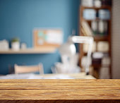 Defocused empty office interior and a wooden background