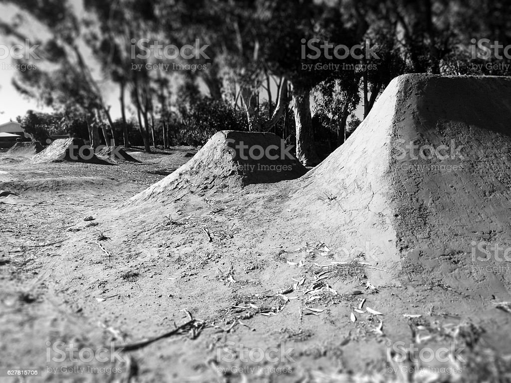 defocused freestyle extreme sports dirt track for stunt riders stock photo