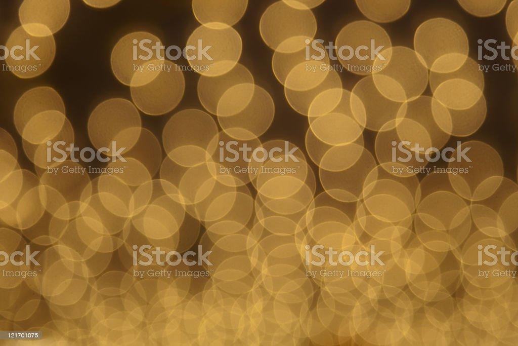 defocused golden light dots against dark background royalty-free stock photo