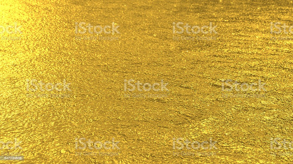 Defocused golden toned water surface texture background stock photo